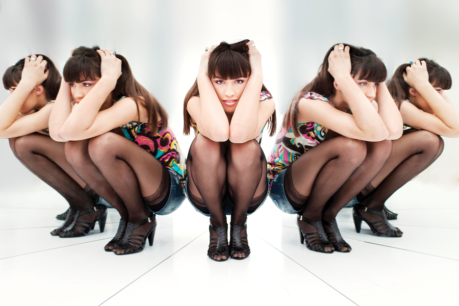 Woman Between Two Mirrors