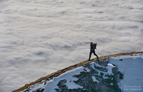 Walking in clouds in the Kamnik Alps of Slovenia
